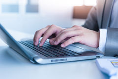Close up of business man hands typing on laptop computer Royalty Free Stock Photo