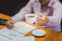 Close-up of business man holding cups Royalty Free Stock Images