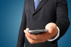 Close up of a business man holding mobile smart phone cell phone Royalty Free Stock Image