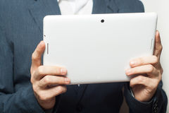 Close up business man holding tablet pc Stock Photo