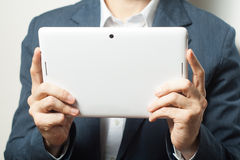 Close up business man holding tablet pc Royalty Free Stock Photography