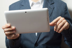 Close up business man holding tablet pc Royalty Free Stock Images
