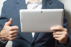 Close up business man holding tablet pc Stock Photos