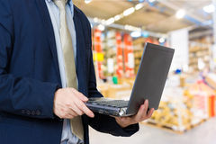 Close up of business man with a laptop, Store industry Royalty Free Stock Photography