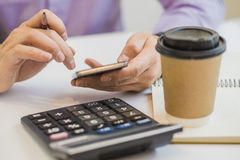 Close up, business man or lawyer accountant working on accounts using a calculator and writing on documents Royalty Free Stock Image