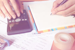 Close up, business man or lawyer accountant working on accounts using a calculator and writing on documents, Stock Photos