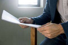 Close up business man with report analysis, selective focus.  royalty free stock photo
