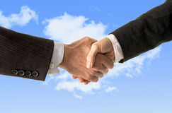 Close up of business man shaking hands with woman isolated on blue sky background Royalty Free Stock Image