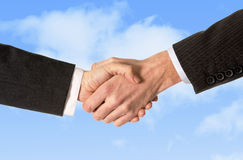 Close up of business man shaking hands with woman isolated on blue sky background Stock Images