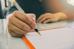 Close up of business man signing contract making a deal royalty free stock photos