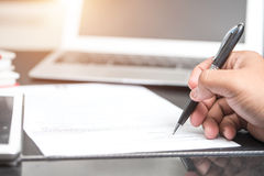 Close up business man signing contract making a deal Stock Photography