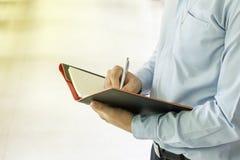 Close up business man signing contract Stock Photos