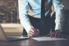 Close up business man signing contract royalty free stock image