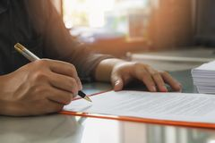 Close up of business man signing contract making a deal stock images