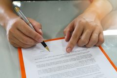 Close up of business man signing contract making a deal. royalty free stock images