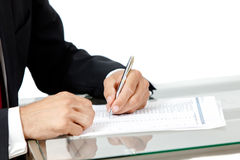 Close-up of business man signing a contract. On white background Royalty Free Stock Photos