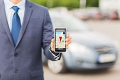Close up of business man with smartphone navigator Stock Images