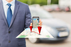 Close up of business man with smartphone navigator Stock Photos