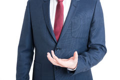 Close-up of business man standing and holding something Stock Photo