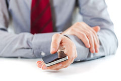 Close up of a business man using a mobile phone Stock Images