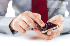 Close up of a business man using a mobile phone. On white background Royalty Free Stock Photo