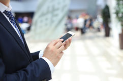 Close up of a business man using mobile Stock Photography