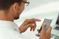 Close up. business men using a modern smartphone stock image