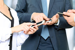 Close up of a business men  and woman using mobile smart phones.  Stock Images
