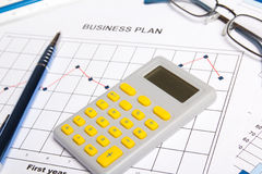 Close up of business papers with graphs, charts and calculator Stock Photo