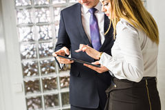 Close-up of business partners looking at document in touchpad Stock Photography