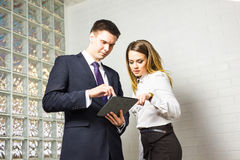 Close-up of business partners looking at document in touchpad Royalty Free Stock Photo