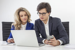Close up of business partners looking at one laptop screen Stock Photography