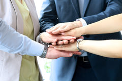 Close-up of business partners making pile of hands at meeting Stock Image
