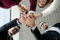 Close-up of business partners making pile of hands at meeting. Team work. royalty free stock image