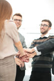 Close-up of business partners making pile of hands at meeting Royalty Free Stock Photos