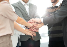 Close-up of business partners making pile of hands at meeting Royalty Free Stock Images