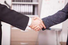 Close up of Business partners shaking hands in the office Stock Photos