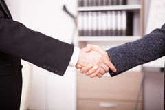 Close up of Business partners shaking hands in the office Royalty Free Stock Image