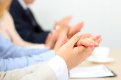 Close-up of business people clapping hands. Business seminar concept Stock Photos