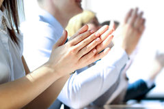 Close-up of business people clapping hands. Business seminar concept Stock Image