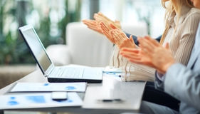 Close-up of business people clapping hands. Royalty Free Stock Photo