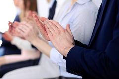 Close up of business people hands  clapping at conference Stock Photography