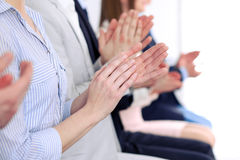Close up of business people hands  clapping at conference Stock Images