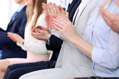 Close up of business people hands  clapping at conference Royalty Free Stock Image