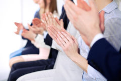 Close up of business people hands  clapping at conference Royalty Free Stock Photography