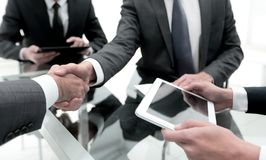 Close up. business people handshake over the Desk.  Stock Photos
