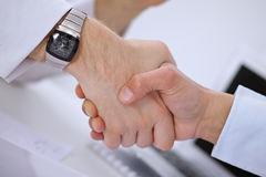 Close up of business people handshaking Royalty Free Stock Photo