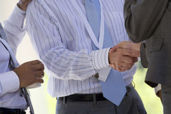 Close up of business people shaking hands stock images