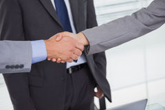 Close up on business people shaking hands Stock Images