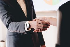 Close up of Business people shaking hands, finishing up meeting, business etiquette, congratulation, merger and acquisition stock images